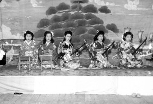 TRADITIONAL ARTS BEHIND BARBED WIRE —  At the Gila River concentration camp is teacher Kineya JyoRokusho (center), and at far right is Masayo Yasui Arii, a co-founder of the San Jose Chidori Band.     photo courtesy of Masayo Arii