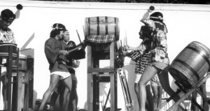PIONEERS OF TAIKO — The second to form was Senshin Buddhist Temple's Kinnara Taiko in 1969. Kinnara performed at pilgrimages to the former concentration camp sites, such as Poston, Ariz. (right) during the height of the Asian American student movement in the 1970s. (From left to right): Rev. Masao Kodani, Johnny Mori, Kenny Endo, Clark Nakashita and Qris Yamashita play on drums they built out of wine-barrels.   courtesy of Kinnara Taiko