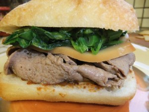 Pork sandwich with broccoli rabe. photo by Ryan Tatsumoto