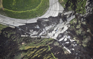 DESTRUCTION — Photo taken from a Kyodo News helicopter (above) shows severe damage to a road following a magnitude-7.3 quake in Minamiaso, Kumamoto Prefecture, on April 16, in the wake of a magnitude 6.5 quake that rocked the area on April 14. Kyodo News photo  ==Kyodo