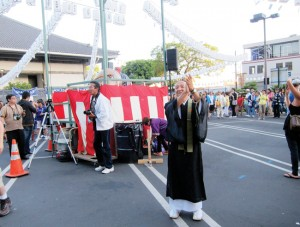 CONTINUING TRADITIONS — Rinban Noriaki Ito applauding performers during Bon Odori at the Higashi Honganji Buddhist Temple in July of 2012. photo by Mika Ito