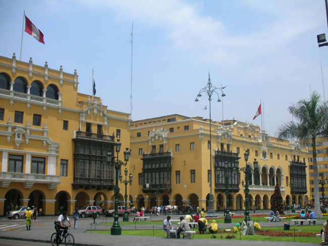 PLAZA MAYOR ­— The distinct yellow buildings (above) border Plaza Mayor in Lima, Peru along with a Cathedral overlooking a grand fountain (left). The plaza is one several UNESCO World Heritage sites in the city. photos by Richie Diesterheft and Jonathan Adrianzen