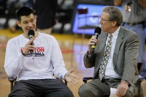 AT EASE — Jeremy Lin sits down with Warriors announcer Jim Barnett for a postgame interview attended by many in the Asian American community. photo by  Scott Nakajima/ Nakajima Photography
