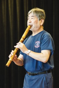 "PLAYING FROM THE HEART — Masayuki Koga (at near and far left) teaches students how to play the shakuhachi (the traditional Japanese flute) by being both ""very funky and very precise."" Koga says that players can channel their emotions to express themselves through the shakuhachi. Above, Koga's students gather for a monthly intensive workshop. photo by Daisuke Tagawa"