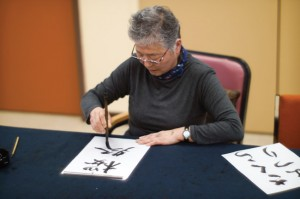 THE PERFECT STROKE — Akie Karahashi demonstrates the art of shodo (Japanese calligraphy). photo by Daisuek Tagawa