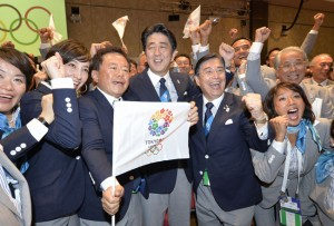 TOKYO WINS OLYMPICS — Japanese Prime Minister Shinzo Abe (center), Tokyo Gov. Naoki Inose (third from left) and other members of the Tokyo bid delegation pose after the Japanese capital was chosen as the city to host the 2020 Summer Olympics at the International Olympic Committee's general session, in Buenos Aires on Sept. 7.       Kyodo News photo