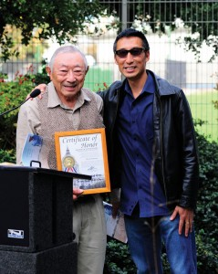 "CITY RECOGNITION — Hiroshi Kashiwagi, author of ""Starting From Loomis and Other Stories,"" receives a Certificate of Honor from the San Francisco Board of Supervisors, presented by Supervisor Eric Mar (R). photo by William Lee"