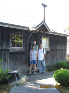 "Nikkei Internment Memorial Centre — Visiting a Nikkei Internment Memorial Centre's World War II ""ghost town"" shack in New Denver, British Columbia, Canada. Twila Tomita, Annie Kim (back) and Andy Noguchi. photo courtesy of Andy Noguchi"
