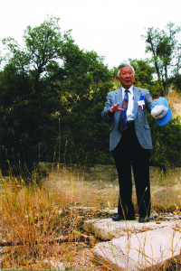TOPAZ RESISTER — Ken Yoshida, a Nisei draft resister from the Topaz concentration camp, stands at the former federal labor camp he was sentenced to during World War II at the 1999 dedication of the Gordan Hirabayashi Recreation Site. He was among 40 Nisei resisters who were sentenced to the site near Tucson. photo by Martha Nakagawa
