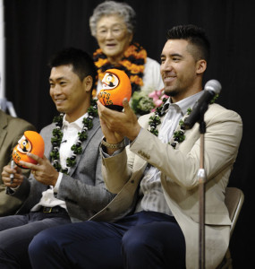 WELCOME TO JAPANTOWN — San Francisco Giants outfielders Norichika Aoki and Travis Ishikawa (left to right) fill out the eye of a daruma crafted in Fukushima, Japan, a gift from the Japanese American community. photo by William Lee
