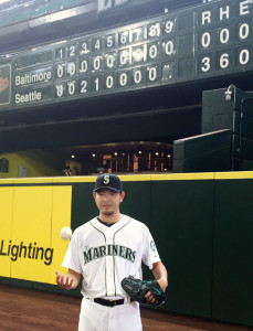Seattle Mariners right-hander Hisashi Iwakuma poses for photos in front of the scoreboard at Safeco Field in Seattle on Aug. 12, 2015, after throwing a no-hitter in a 3-0 win over the Baltimore Orioles. Iwakuma became the first Japanese pitcher to throw a major league no-hitter since Hideo Nomo, who did so twice in 1996 and 2001. Kyodo News photo