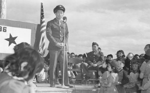 HERO'S WELCOME — Sgt. Ben Kuroki responding to a speech of welcome given by Project Director Guy Robertson and representatives of the Community Council upon his arrival at Heart Mountain, Wyo. on April 24, 1944. photo by Bud Aoyama/UC Berkeley, Bancroft Library