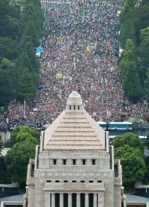 Photo taken from a Kyodo News helicopter shows hundreds of thousands of people protesting at the parliament building in Tokyo on Aug. 30, 2015, against the government's security bills that would allow Japan to exercise the right to collective self-defense and expand overseas operations of the Self-Defense Forces. About 120,000 people took part, according to organizers. (Kyodo) ==Kyodo