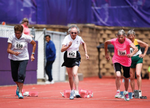 Patricia Fujii, 83, second from left, of Meridian, ID, competes in 50m dash at the National Senior Games presented by Humana on Thursday, July 9, 2015, in St. Paul, Minn. Fujii was honored as a Humana Game Changer for serving as an inspiration to people of all ages to get active. She began exercising after a bout with breast cancer and believes the friendships she makes on the field are more important than your competition results. (Photo by Craig Lassig/Invision for Humana/AP Images)