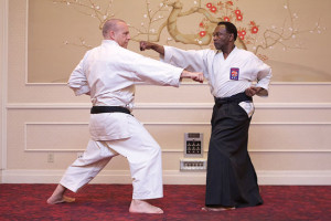 PACKING A PUNCH — Bernard Edwards Shihan, right, demonstrates karate at the Japanese American Association of Northern California Bunka (Culture) Hall of Fame induction ceremony earlier this year. A pioneer in American karate, Edwards said he is running the longest-existing martial arts organization on the Bay Area Peninsula.  photo courtesy of the Japanese American Association of Northern California