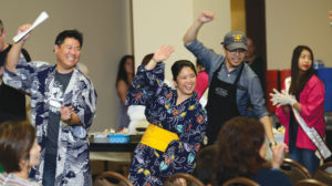 "Emcees Mike Inouye of NBC Bay Area and Jana Katsuyama of KTVU Fox 2 dance to San Jose Taiko's ""Ei Ja Nai Ka."" photo by William Lee"