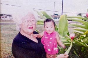 Barbara Funamura with her granddaughter Justice Funamura-Sasil in a 2002 photograph. Dennis Fujimoto/The Garden Island