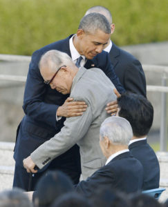 HISTORIC VISIT — U.S. President Barack Obama (L) hugs Shigeaki Mori, a 79-year-old survivor of the U.S. atomic bombing, at the Peace Memorial Park in Hiroshima on May 27. Obama became the first sitting U.S. president to visit the atomic-bombed city that day. Kyodo News  pool photo
