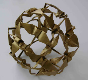 """The Peace Sphere"" (far left), folded by Linda Mihara from one sheet of paper. photo by Linda Mihara"