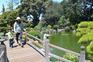 SAN MATEO COMMUNITY JEWEL — Majken Bullard and her 4-year-old son Jack take their first stroll through San Mateo's Japanese Garden in Central Park. The city is hosting 50th anniversary celebrations throughout August. photo by Samantha Weigel/San Mateo Daily Journal